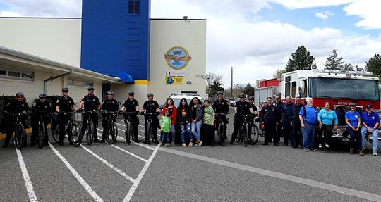 Volunteers and participants of the first annual Optimist Club of Reno Bike Rodeo line up for a photo on Saturday, April 20, 2019.