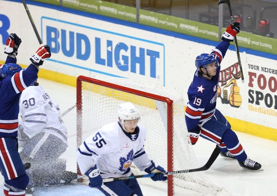C.J. Smith (19) of the Amerks celebrates his goal against the Toronto Marlies during the  Calder Cup Playoffs.