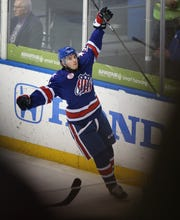Amerks C.J. Smith (19) celebrates his goal against the Toronto Marlies during the Calder Cup Playoffs. Smith has 45 goals in two seasons and is back.