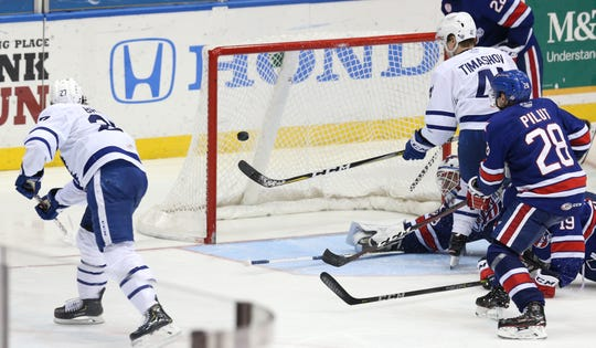 Toronto Marlies Jeremy Bracco (27) scores the winning over time goal against the Amerks during Calder Cup Playoffs.