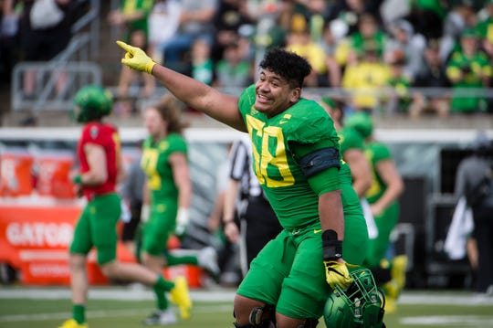 Oregon Ducks offensive lineman Penei Sewell (58) points the scoreboard after the Oregon spring game at Autzen Stadium. Mighty Oregon beat Fighting Ducks 20-13.