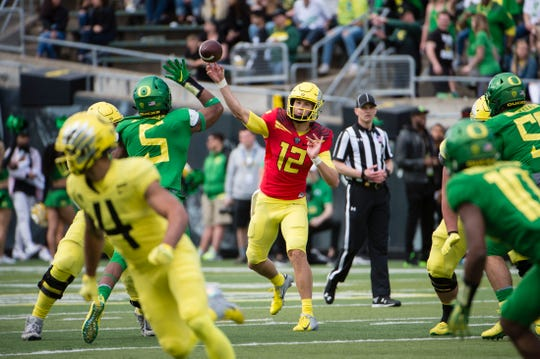Apr 20, 2019; Eugene, OR, USA; Oregon Ducks quarterback Tyler Shough (12) passes the ball during the second half during the Oregon spring game at Autzen Stadium. Mighty Oregon beat Fighting Ducks 20-13.  Mandatory Credit: Troy Wayrynen-USA TODAY Sports