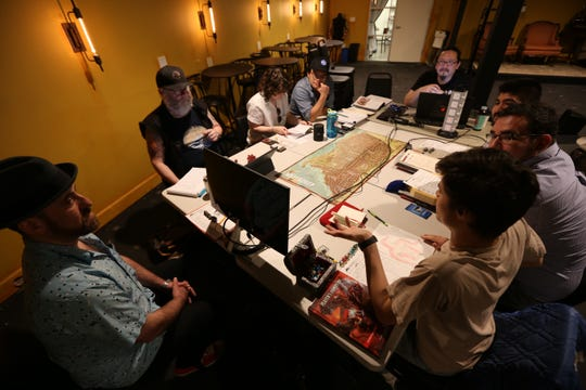 Clockwise from far left: David Wolkovich, Doug Luberts, Molly Becker, Kris Huelgas, game leader Mario Alvarenga, Carlos Ortega and Alexander Lopez play Dungeons and Dragons at Geeky Teas in Burbank, Calif., on April 13.