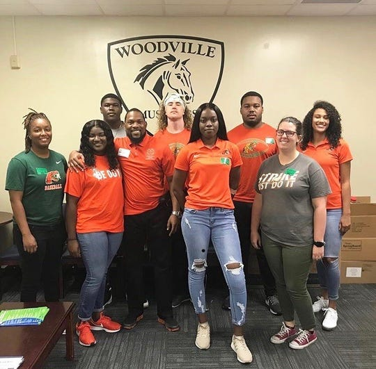 From left to right: FAMU athletic adviser Jasmine Rich, Keondra Eaton (bowling) Anthony Williams, Jatia Littles (volleyball), FAMU athletics adviser Carrie Hickey. Back Row: Marquise Sailor (football), Ryan Stanley (football), Bryan Crawford (football) and Alexis Gosha (volleyball) represent FAMU SAAC at Woodville Elementary School on Field Day.