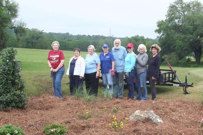From left to right: Mary Courtemanche, Wilma Scofield, Jane Parrish, Betty Davis, Wayne Leclere, Merry Sutton, Judy Leclere, and Fran Felix, DAR members and helper, at the pollinator garden.