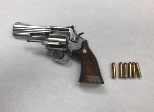 A firearm and ammunition were seized Saturday night during contact with a man who was on probation, police said.