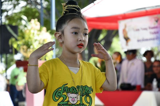 Aria Deechaleune, 4, performs at the Lao New Year Celebration at the Lao Buddhist Temple of Visalia on Saturday, April 20, 2019.