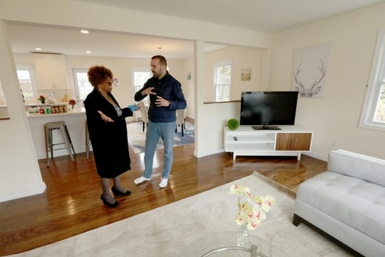 Valon Nikci, broker/owner of Link NY Realty in Bronxville speaks with Mary Spells during an open house in White Plains April 21, 2019.