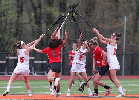 North Rockland (in red) rebounded from its loss to Suffern to defeat Briarcliff (in white) 21-10 Saturday, April 20, 2019 at Briarcliff. Here players battle for a loose ball.