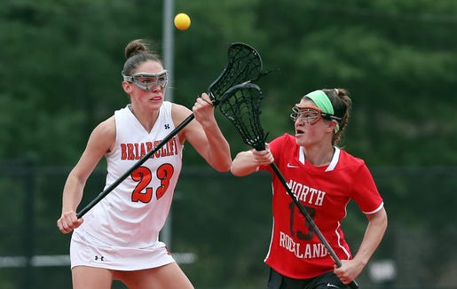 From left Briarcliff's Kelly O'Donnell (23) and North Rockland's Kerri Gutenberger (13) battle for ball control during girls lacrosse action at Briarcliff High School April 20, 2019. North Rockland won the game.