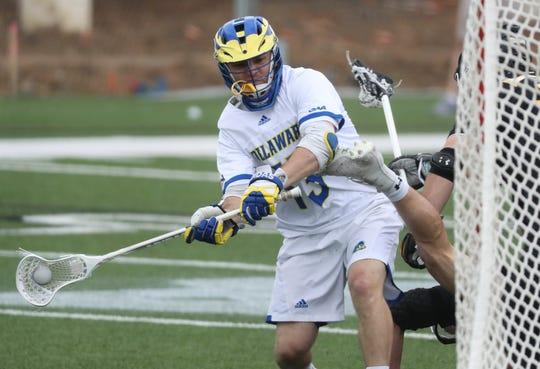 Delaware's Dean DiSimone shoots in the Blue Hens' 14-12 loss at Delaware Stadium Saturday.