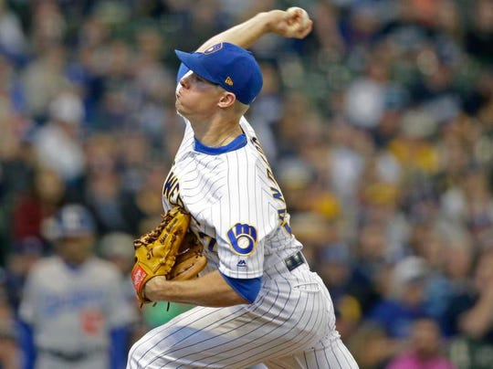 Milwaukee's Chase Anderson earned his first start on Saturday and pitched five scoreless innings for the win.