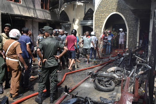 Locals and police gather at the Secon church Batticalova central road in Colombo, Sri Lanka, 21 April 2019. According to the news reports at least 138 people killed and over 400 injured in a series of blasts during the Easter Sunday service at St Anthony's Church in Kochchikade, Shangri-La Hotel and Kingsbury Hotel with many more places.