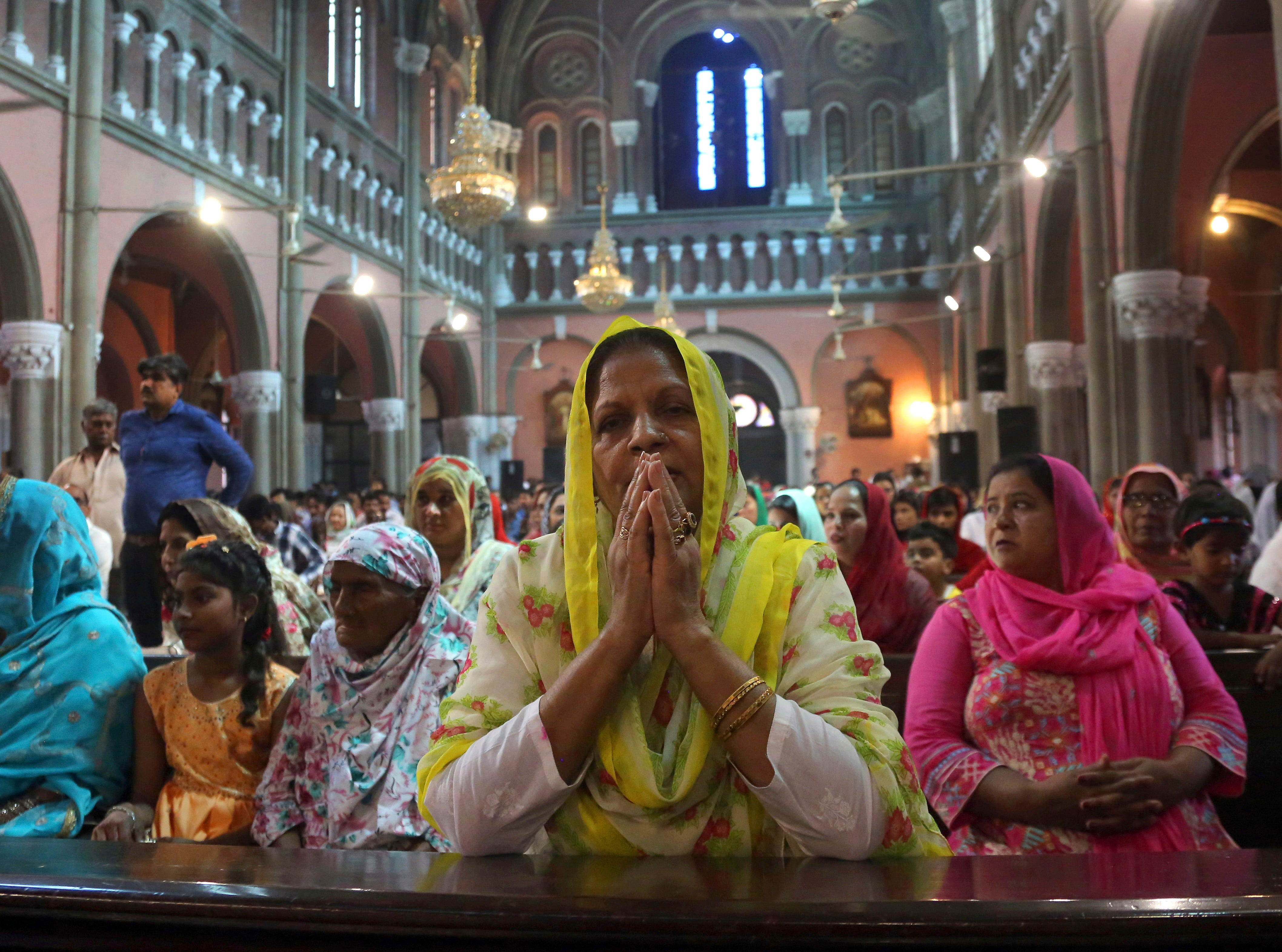 A Pakistani Christian woman prays during Easter mass at Catholic Sacred Heart Cathedral in Lahore, Pakistan on April 21, 2019.