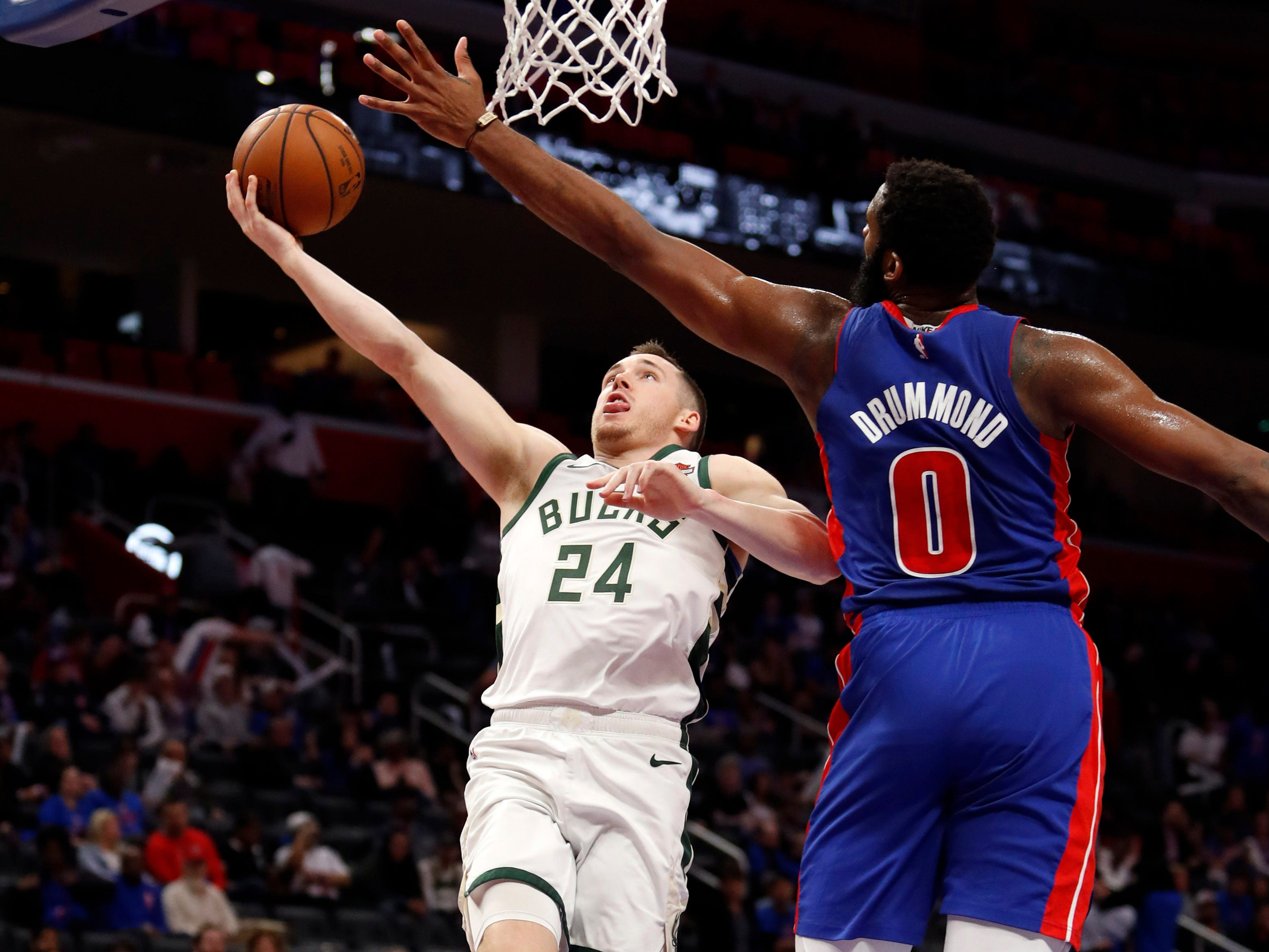 April 20: Bucks guard Pat Connaughton (24) drives to the hoop against Pistons defender Andre Drummond (0) during Game 3.