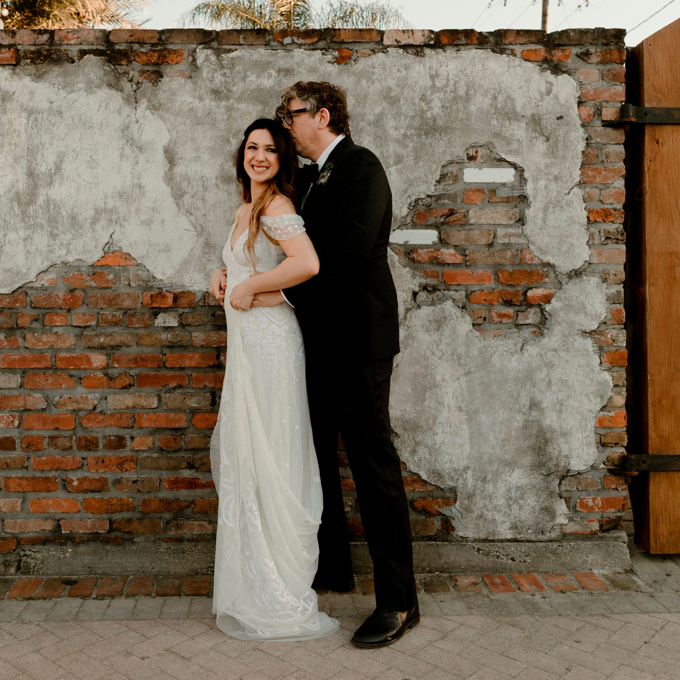 In this Saturday, April 20, 2019, photo provided by Katch Silva, Michelle Branch and Patrick Carney pose for a photo in New Orleans. The Grammy-winning musicians tied the knot Saturday at the Marigny Opera House in front of close friends and family, a representative for Carney told The Associated Press on Sunday. (Katch Silva via AP) ORG XMIT: NYJK710