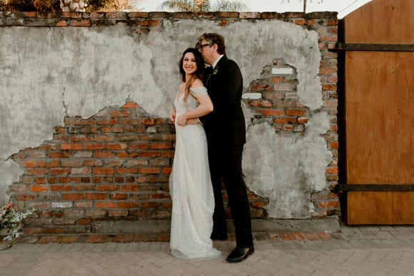 In this April 20, 2019, photo provided by Katch Silva, Michelle Branch and Patrick Carney pose for a photo in New Orleans. The Grammy-winning musicians tied the knot Saturday at the Marigny Opera House in front of close friends and family, a representative for Carney told The Associated Press on Sunday.