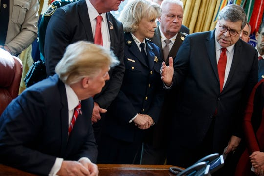 Attorney General William Barr talks with President Donald Trump at the White House on March 15, 2019.