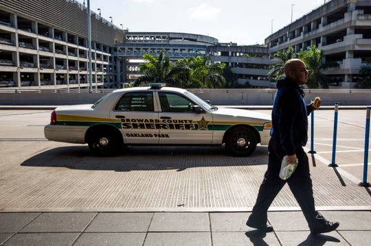 Jan 8, 2017, Fort Lauderdale, FL, USA; A Broward County Sheriff's Department patrol car is parked outside of Fort Lauderdale-Hollywood International Airport. Mandatory credit: Dorothy Edwards/Naples Daily News via USA TODAY NETWORK ORG XMIT: FLNAP101 ORIG FILE ID:  20170108_pjc_usa_221.JPG