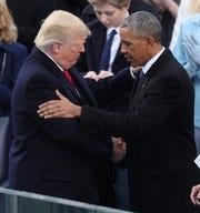 Barack Obama embraces Donald Trump  at Trump's inaugural in Washington on Jan. 20, 2017.