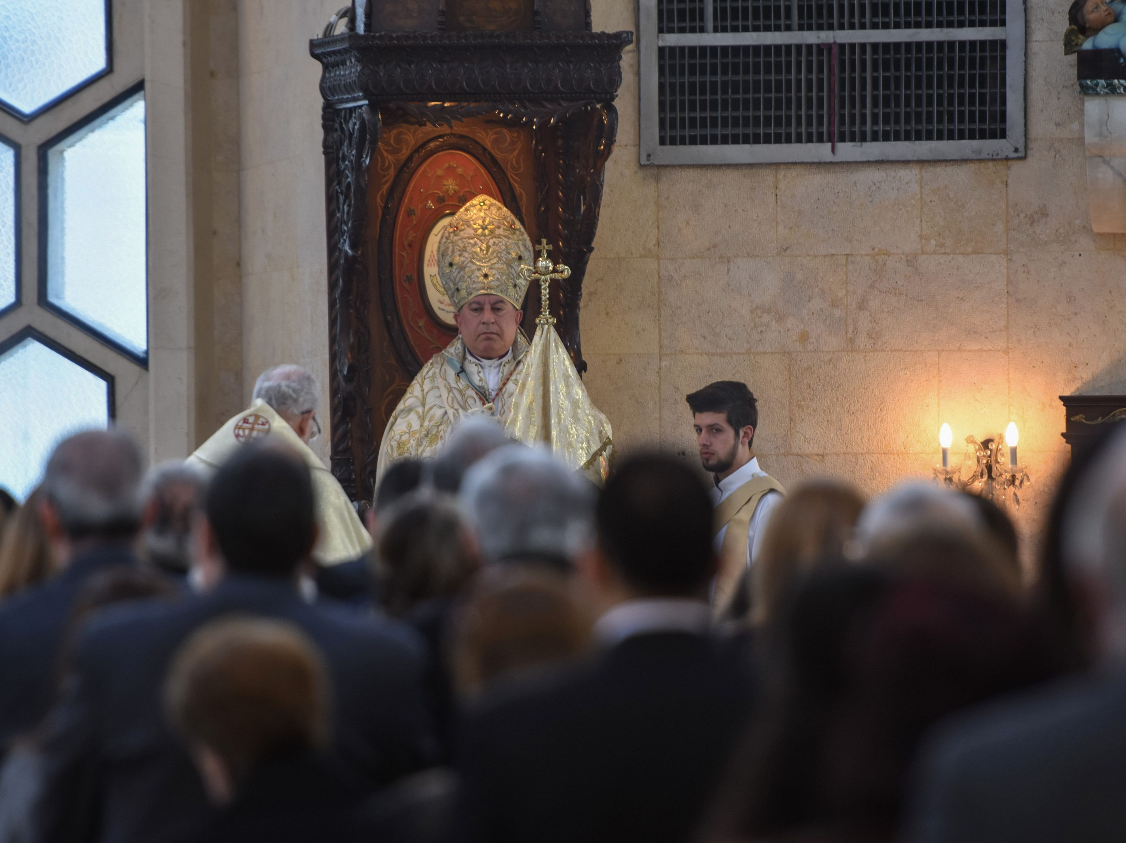 Syrian Syriac Catholics attend the Easter Mass at a church in Syria's northern city of Aleppo on April 21, 2019.