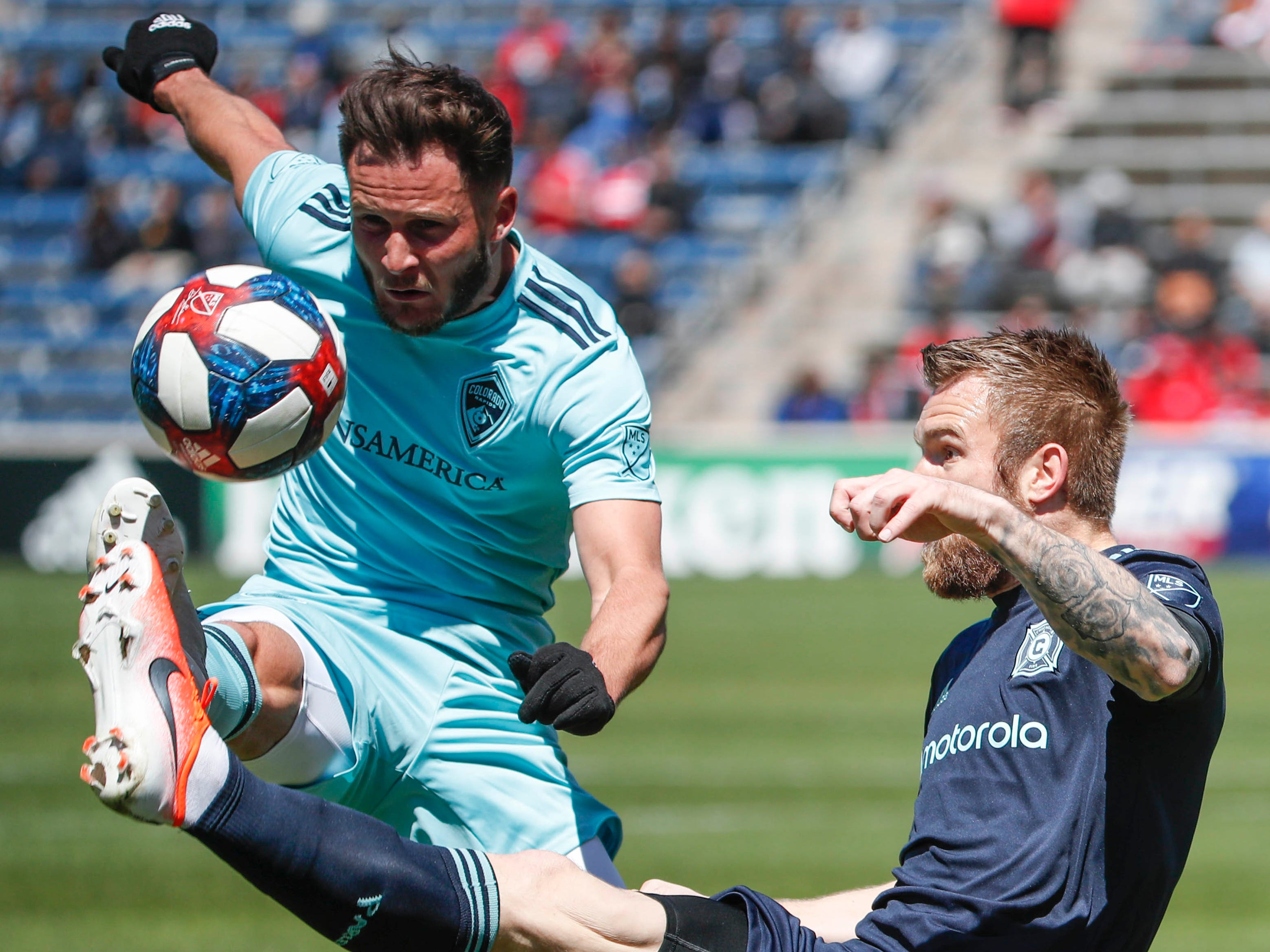 April 20: Chicago Fire forward Aleksandar Katai (10) battles for the ball with Colorado Rapids defender Keegan Rosenberry during the first half at Bridgeview Stadium. Chicago won the game, 4-1.