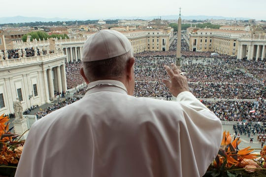 Pope Francis delivers the Urbi et Orbi blessing to the city and to the world from the balcony of St Peter's basilica after Easter Sunday Mass at the Vatican on April 21, 2019.