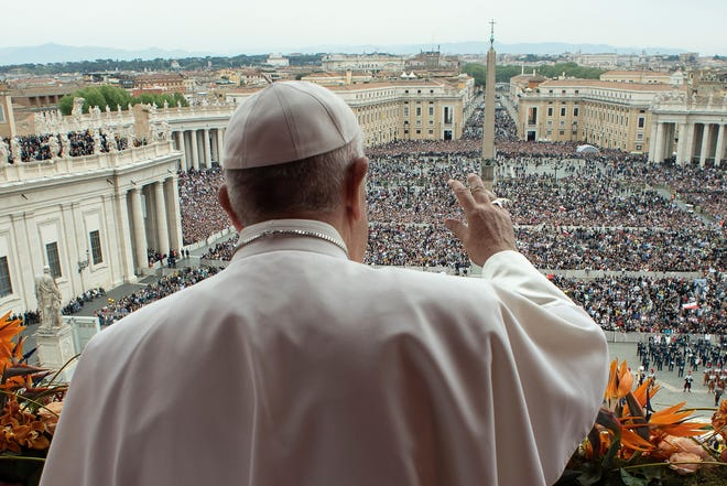Pope Francis delivers the Urbi et Orbi blessing from the balcony of St. Peter's basilica after Easter Sunday Mass at the Vatican on April 21, 2019.