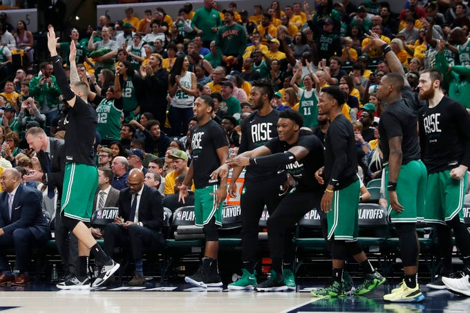 April 21: The Celtics bench celebrates during the fourth quarter of Game 4 against the Pacers in Indianapolis. Boston swept Indiana in the first-round series.