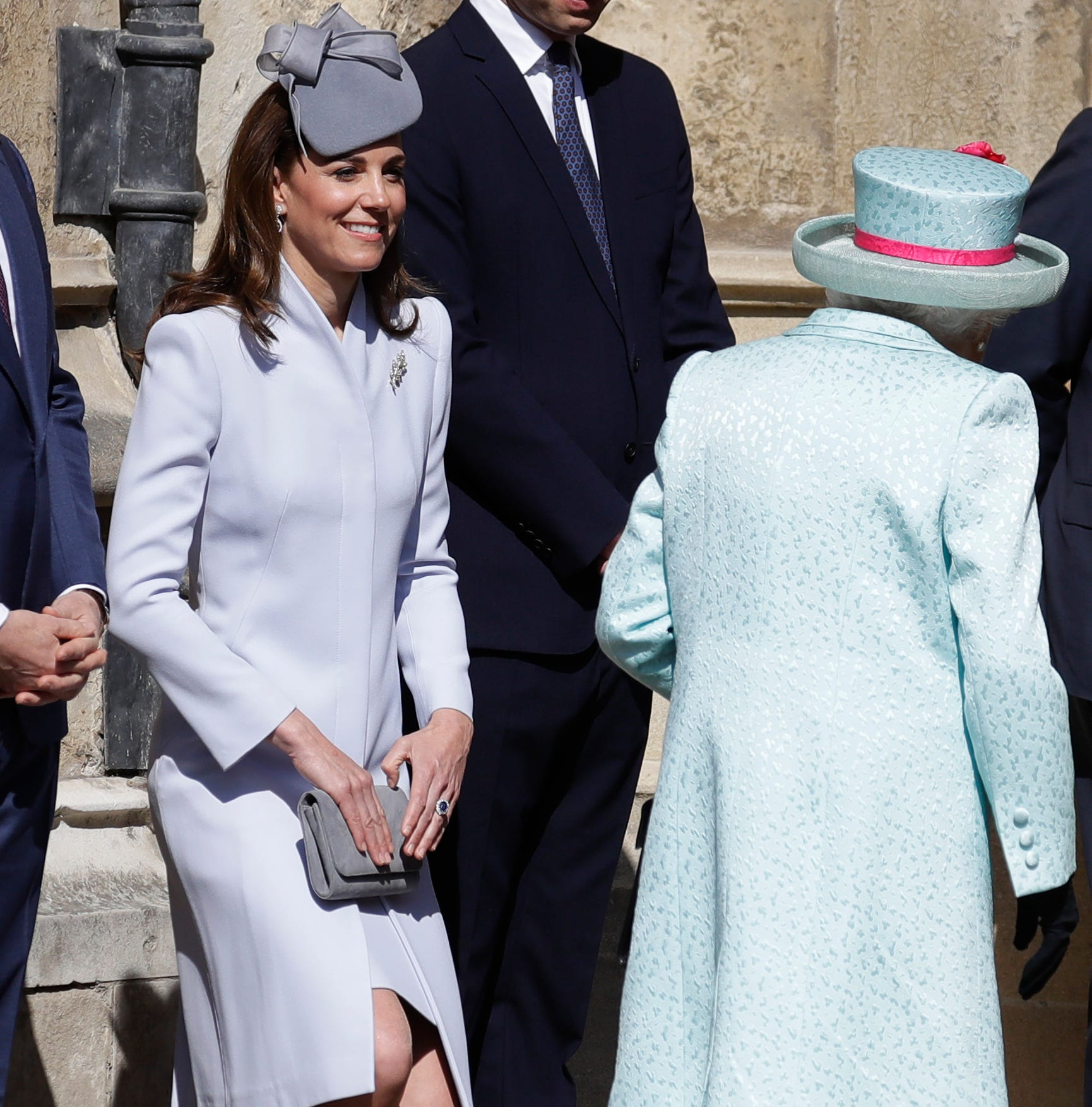 Duchess Kate curtsies as Britain's Queen Elizabeth II arrives to attend the Easter Mattins Service at St. George's Chapel.