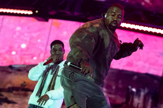 Rappers Kid Cudi (L) and Kanye West (R) perform during the Coachella Valley Music and Arts Festival in Indio near Palm Spring, California, USA, late 20 April 2019.
