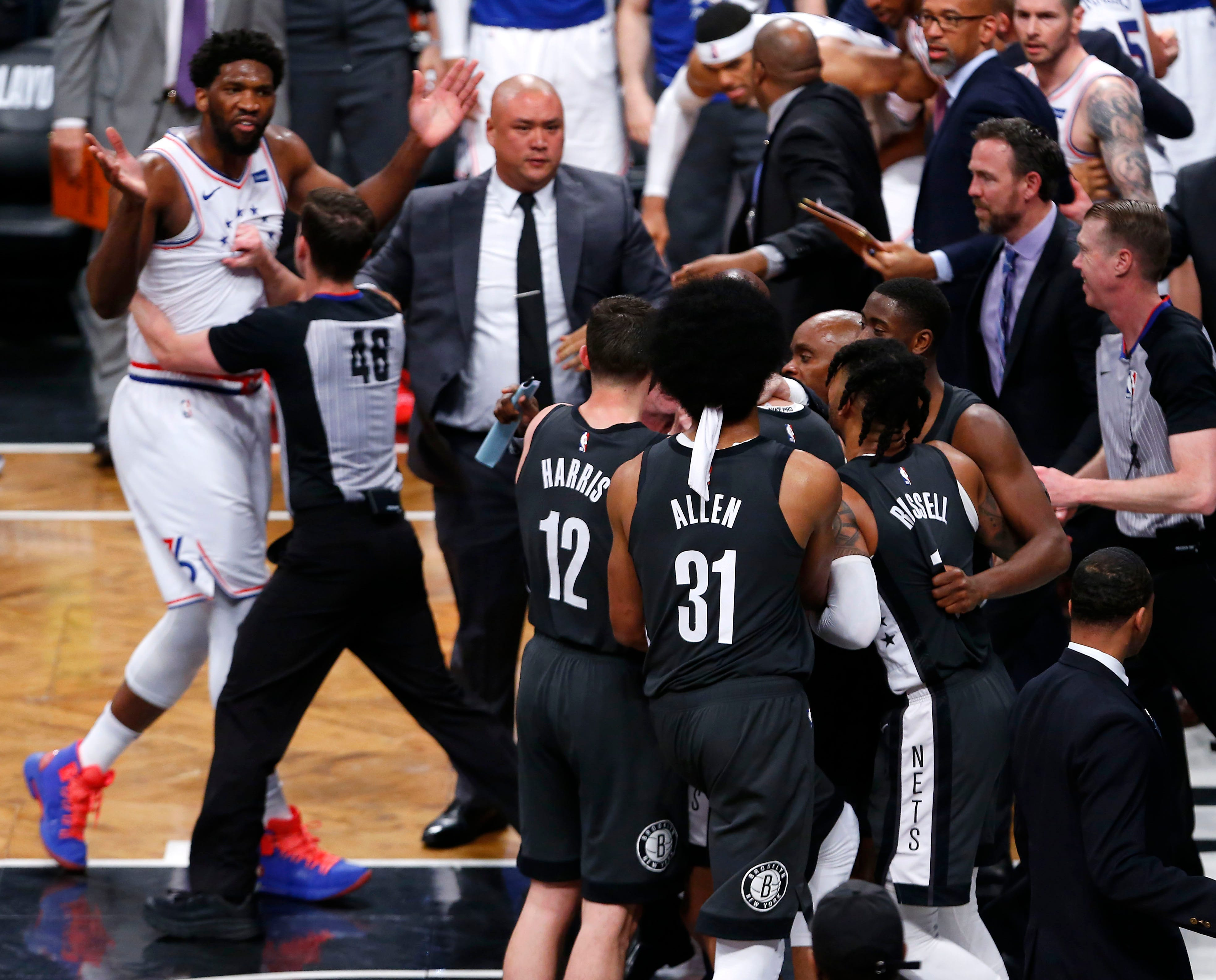 April 20: Sixers center Joel Embiid, left, is held back by referee Scott Foster from an altercation with the Nets during Game 4 in Brooklyn.
