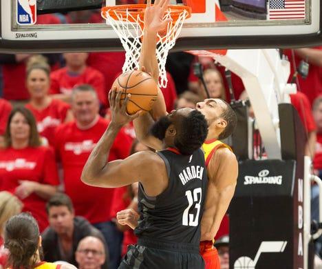 April 20: Jazz center Rudy Gobert (27) stuffs Rockets guard James Harden (13) at the rim during Game 3.