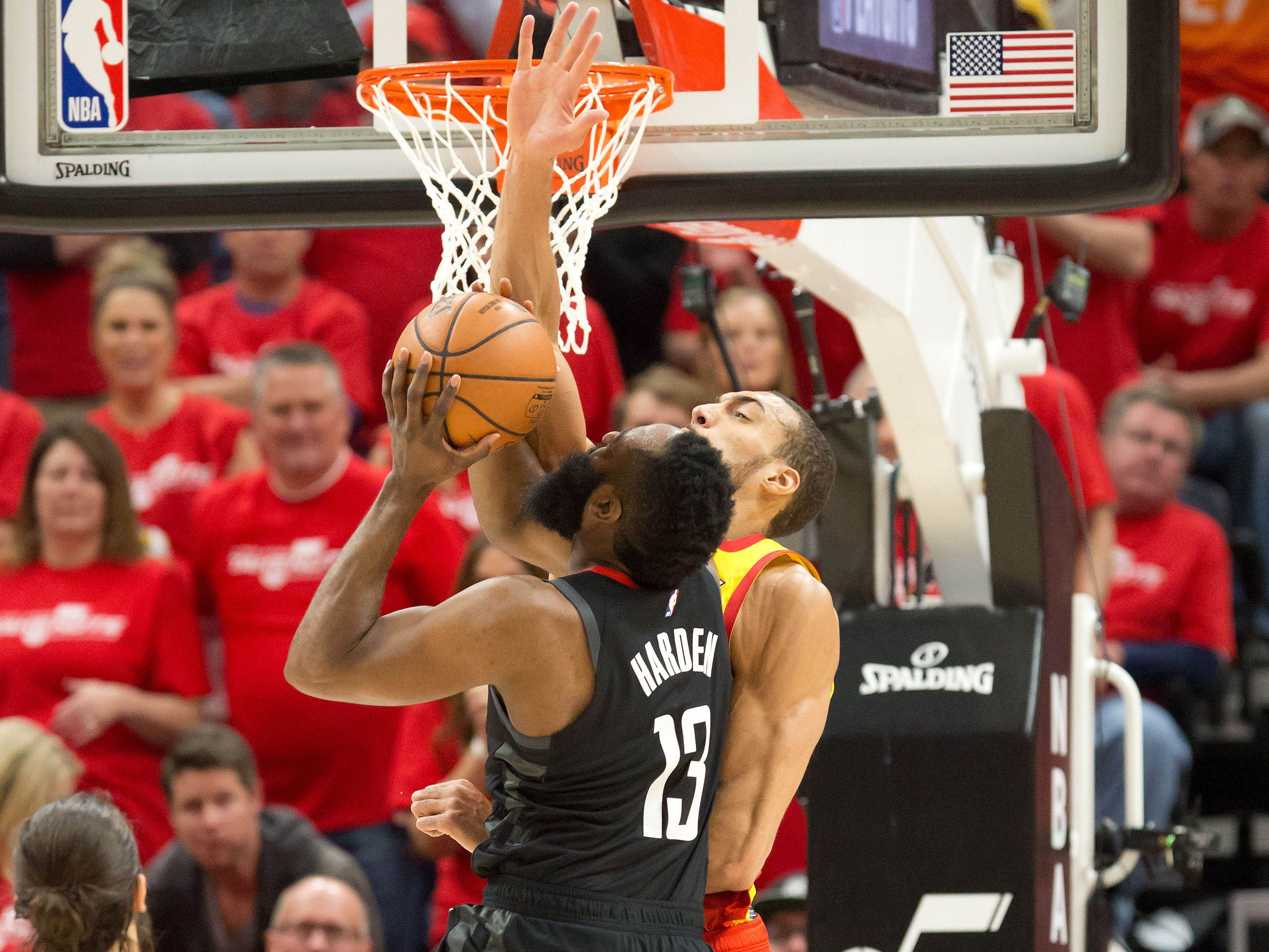 April 20: Jazz center Rudy Gobert (27) stuffs Rockets guard James Harden (13) at the rim during Game 3.