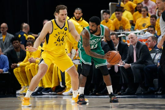 Celtics guard Kyrie Irving (11), working on Pacers forward Bojan Bogdanovic (44), tallied 14 and seven assists in Game 4.