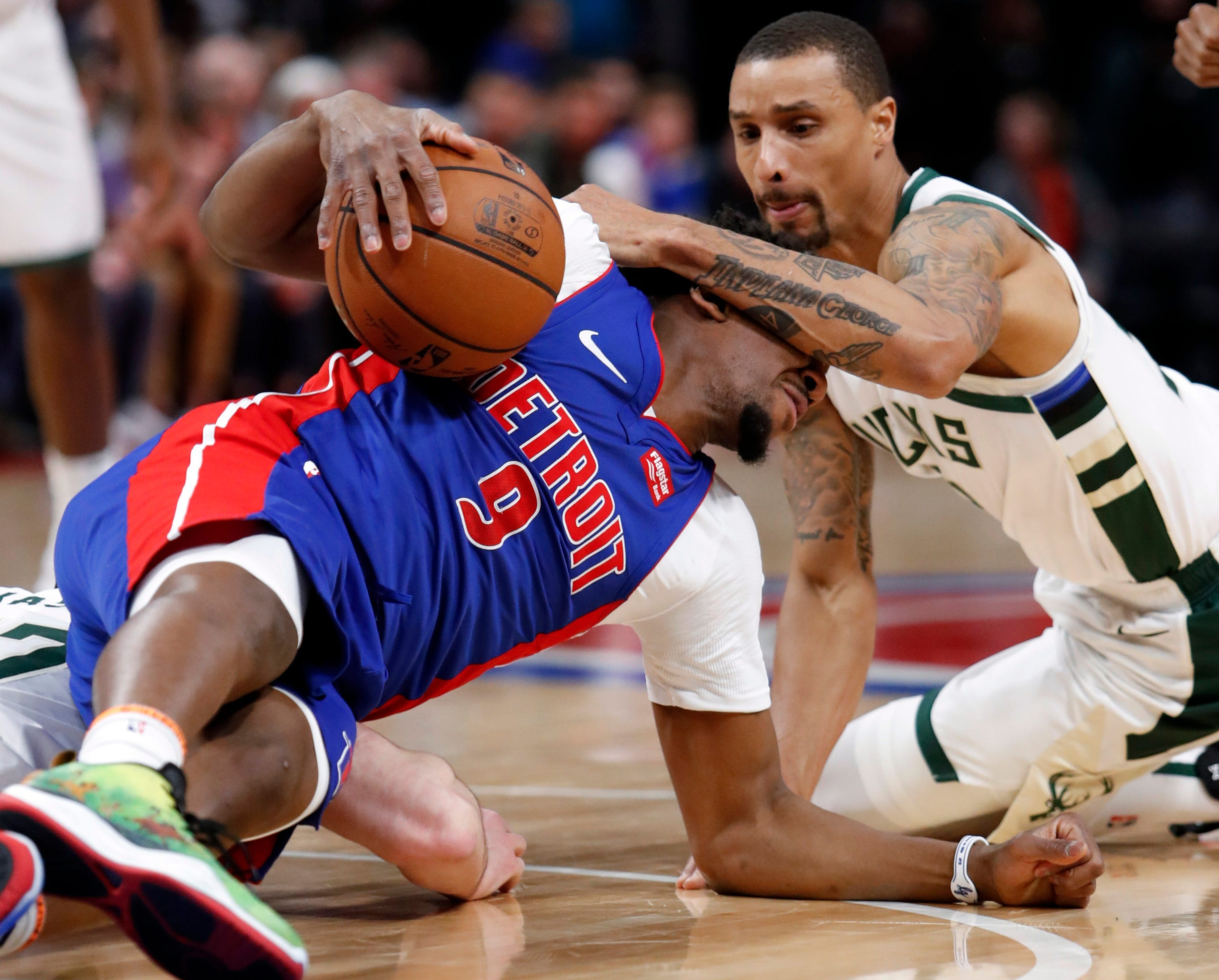 April 20: Pistons guard Langston Galloway (9) corrals a loose ball despite the hit from Bucks guard George Hill (3) during Game 3 in Detroit.