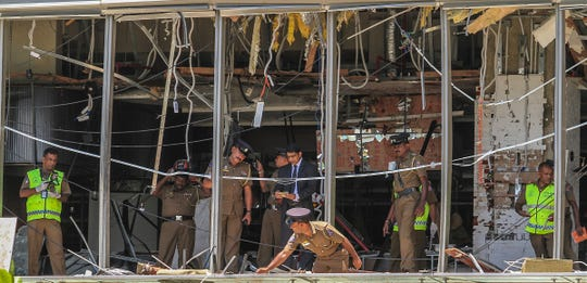 A Sri Lankan Police officers inspect the site of a bomb blast at the Shangri-la hotel in Colombo, Sri Lanka on April 21, 2019.