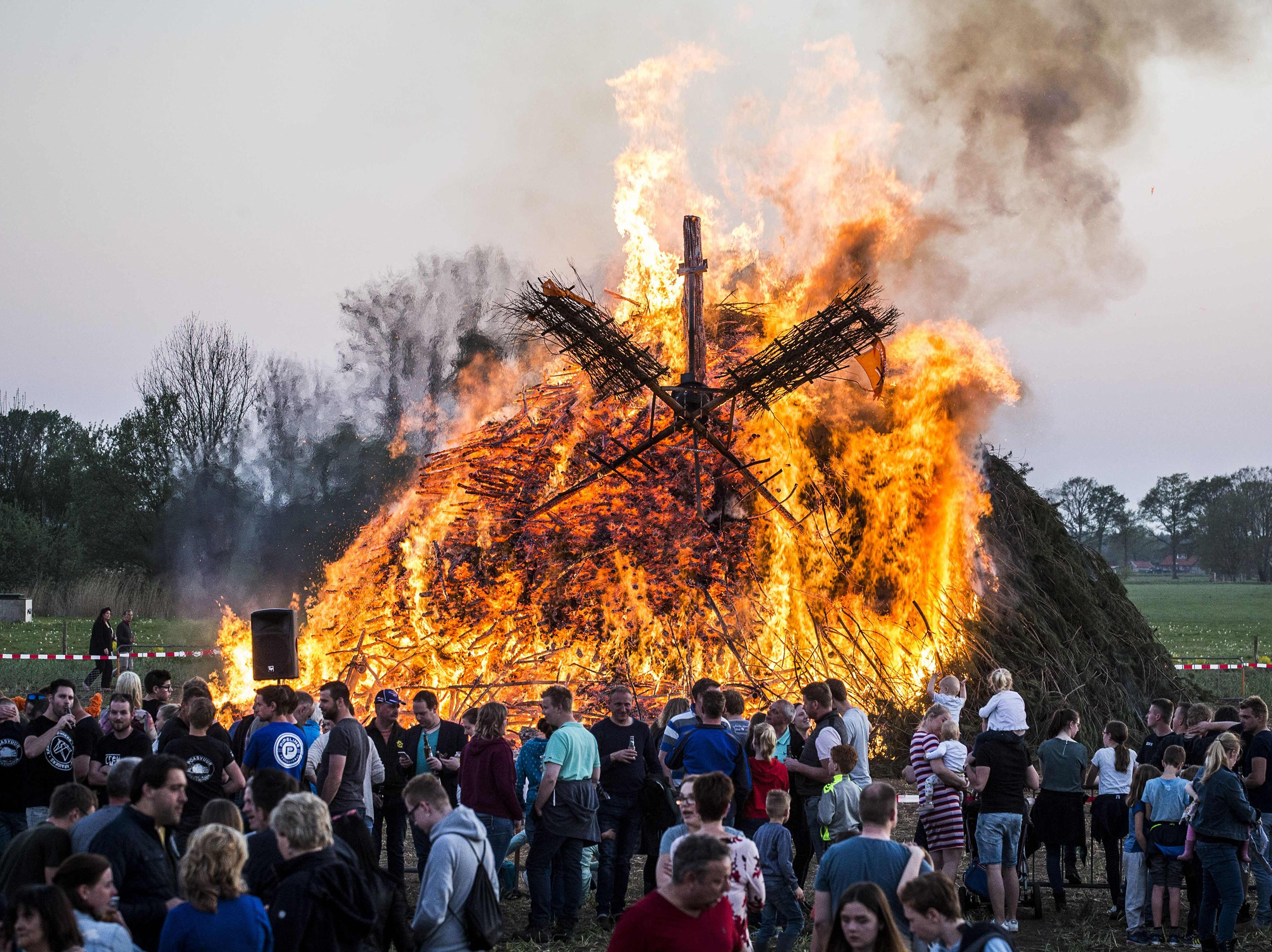 People look at a traditional Easter fire marking Easter Sunday, on April 21, 2019 in Dijkerhoek, Netherlands.