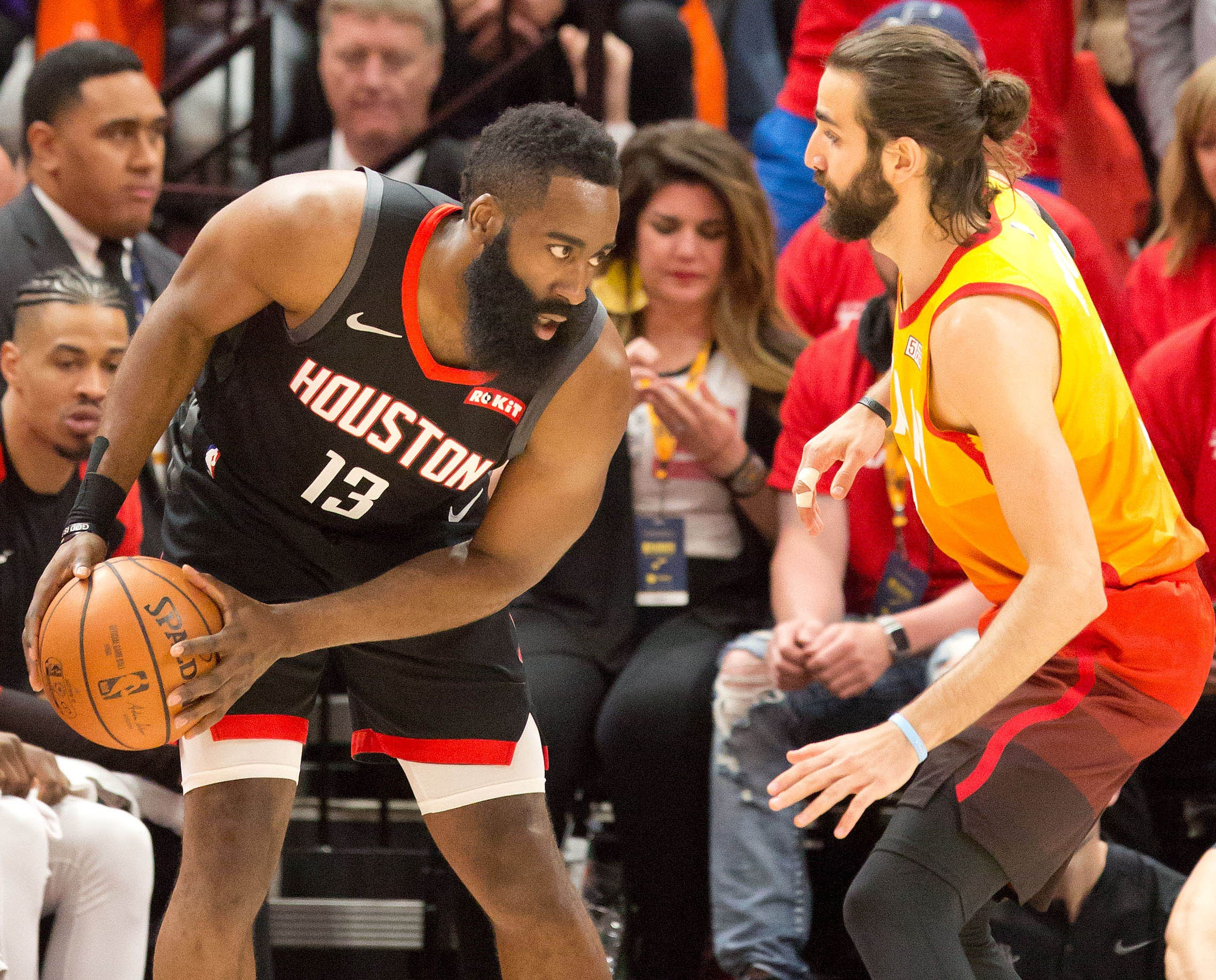 April 20: Rockets guard James Harden (13) looks for room to maneuver on the perimeter against Jazz defender Ricky Rubio (3) during Game 3 in Salt Lake City.