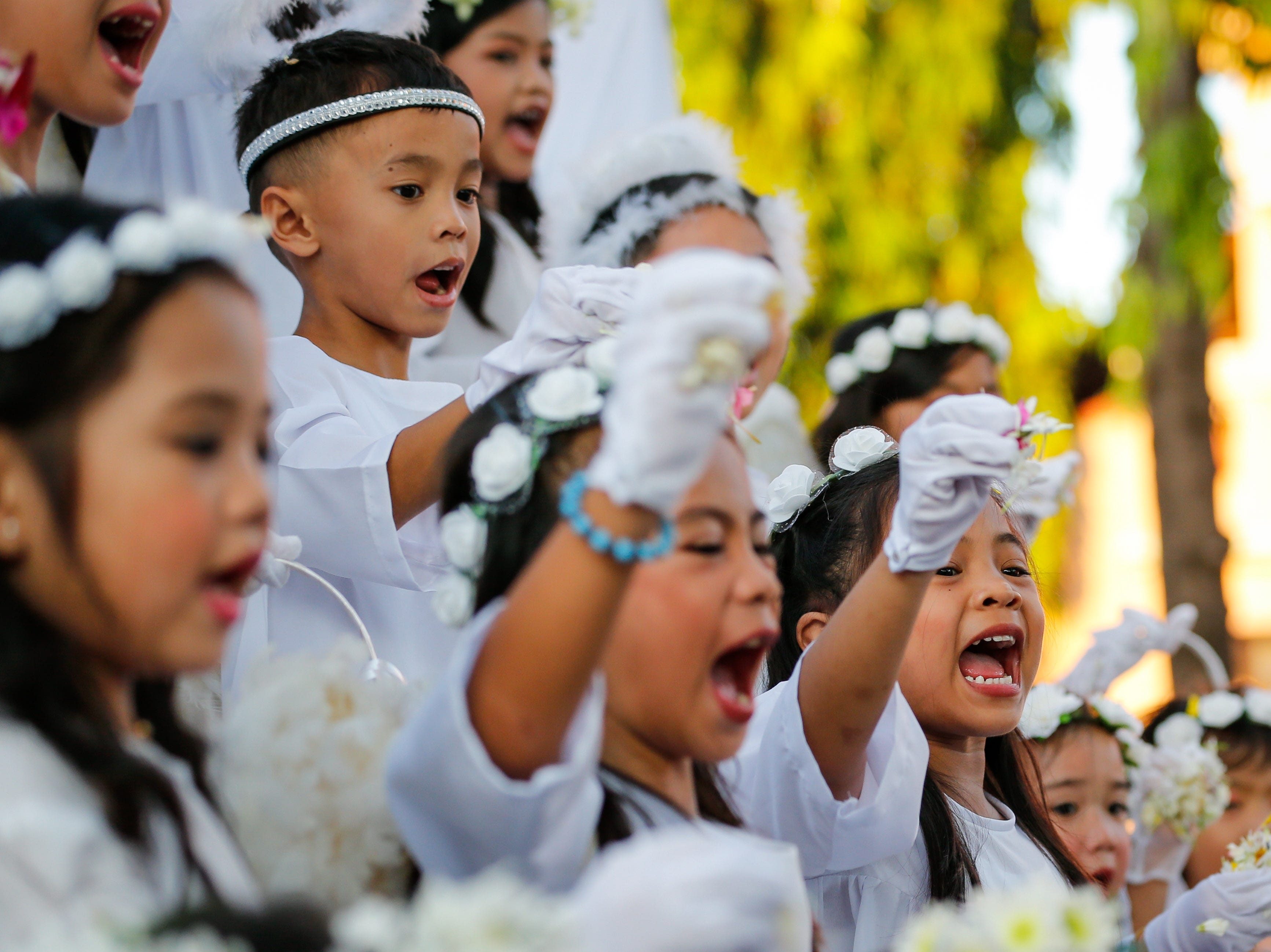 Children dressed as angels perform during the Easter Sunday celebration called Salubong in Santo Tomas, Pampanga, Philippines on April 21, 2019. The Salubong is a re-enactment of the meeting of the Virgin Mary and the risen Jesus Christ.