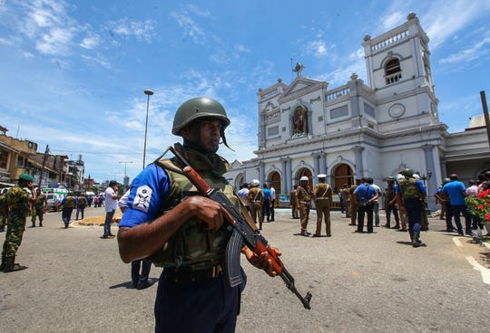 Sri Lankan security forces secure the area around St. Anthony's Shrine after an explosion in Kochchikade, Sri Lanka on April 21, 2019.