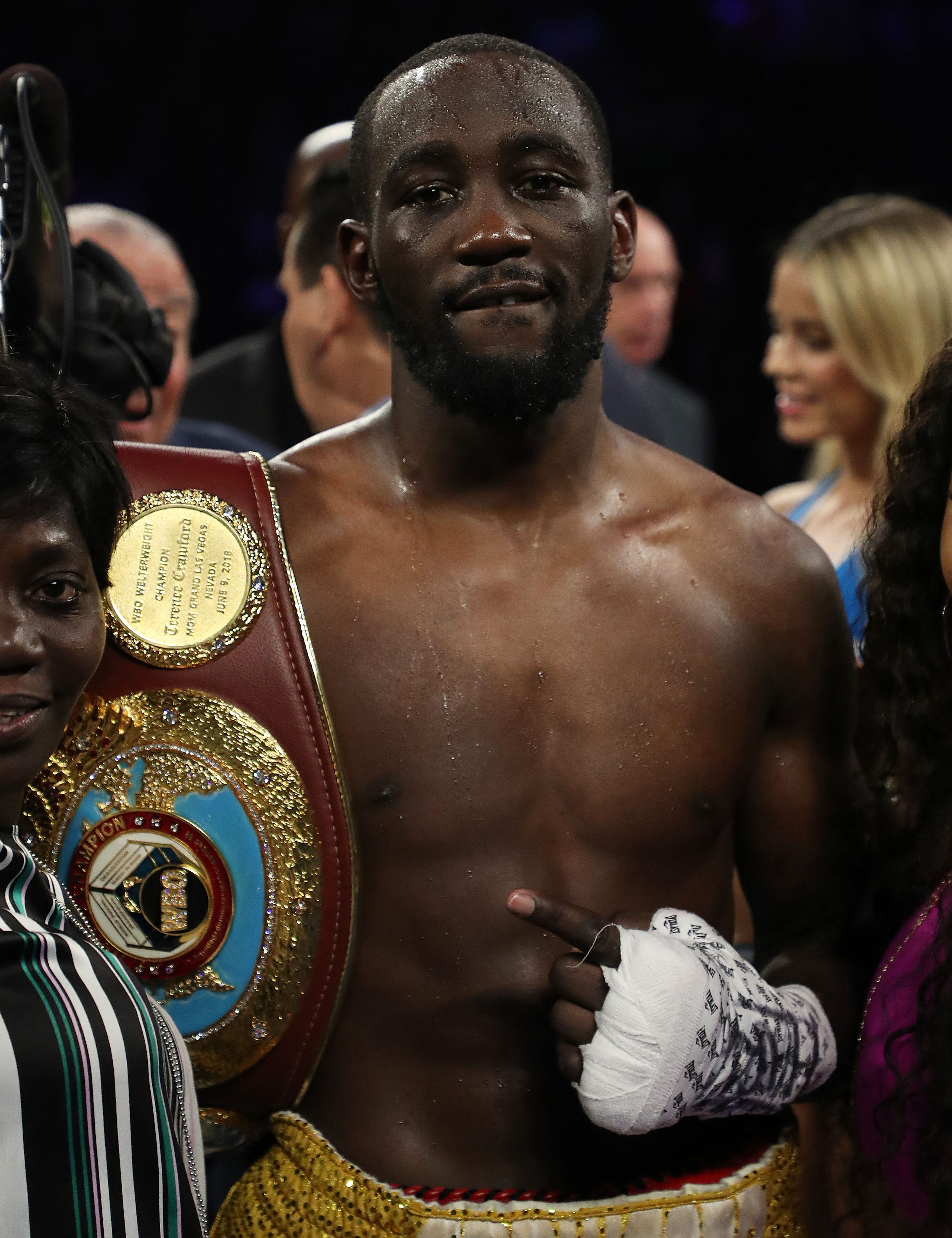 Terence Crawford celebrates his sixth round stoppage due to a low blow against Amir Khan.