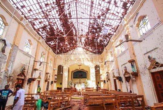 Sri Lankan officials inspect St. Sebastian's Church in Negombo, Sri Lanka after an explosion on April 21, 2019.
