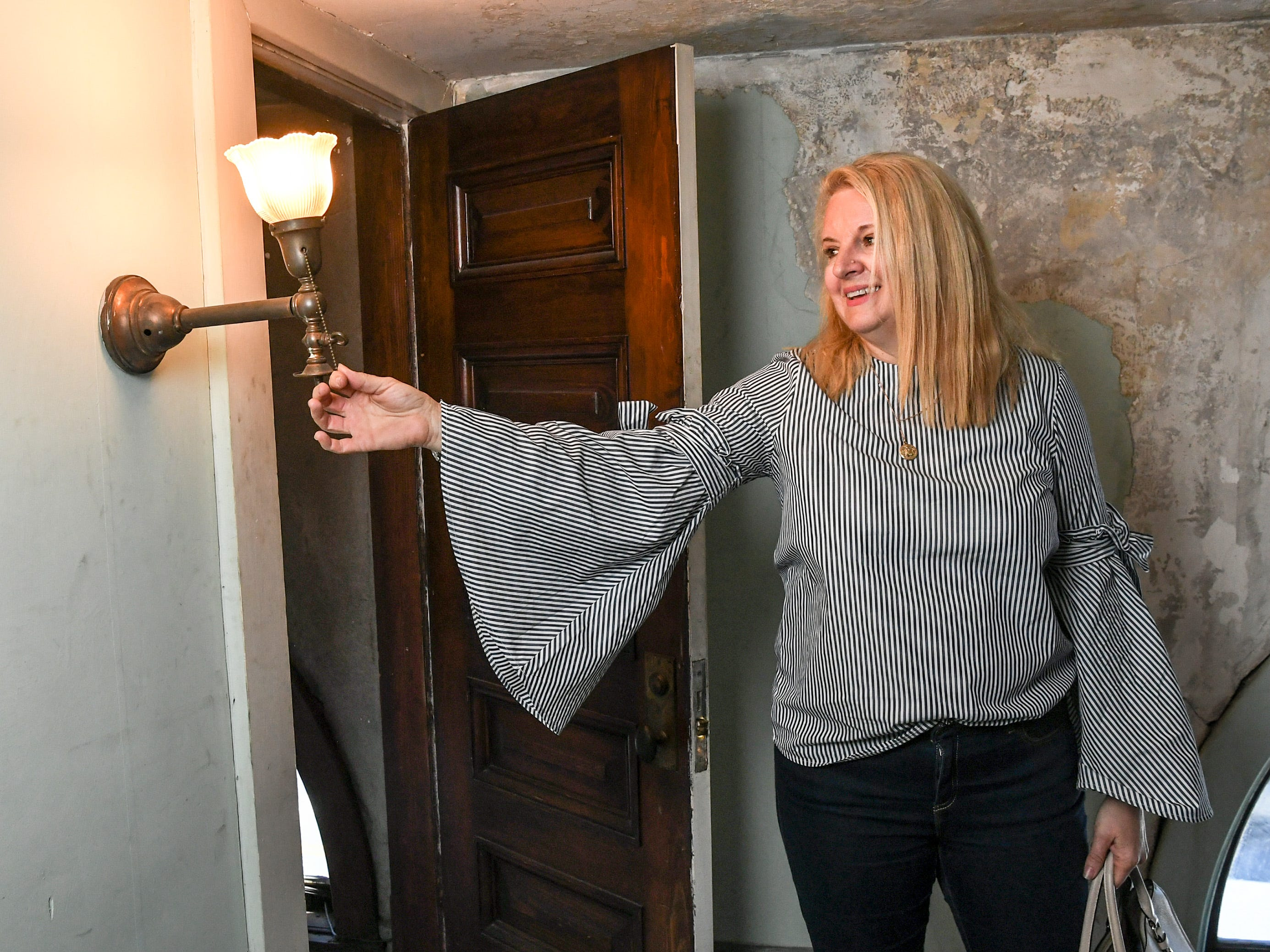 Ann Kummrow looks at a light upstairs in the building she and her husband Rick bought at 401 North Main Street in downtown Anderson. The couple pitched their plan to create The Historic Postmark Anderson, a mix of housing upstairs, retail on the main floor, and possibly a restaurant downstairs. The structure built in 1909 was previously a funeral home, and before that a United States Post Office.