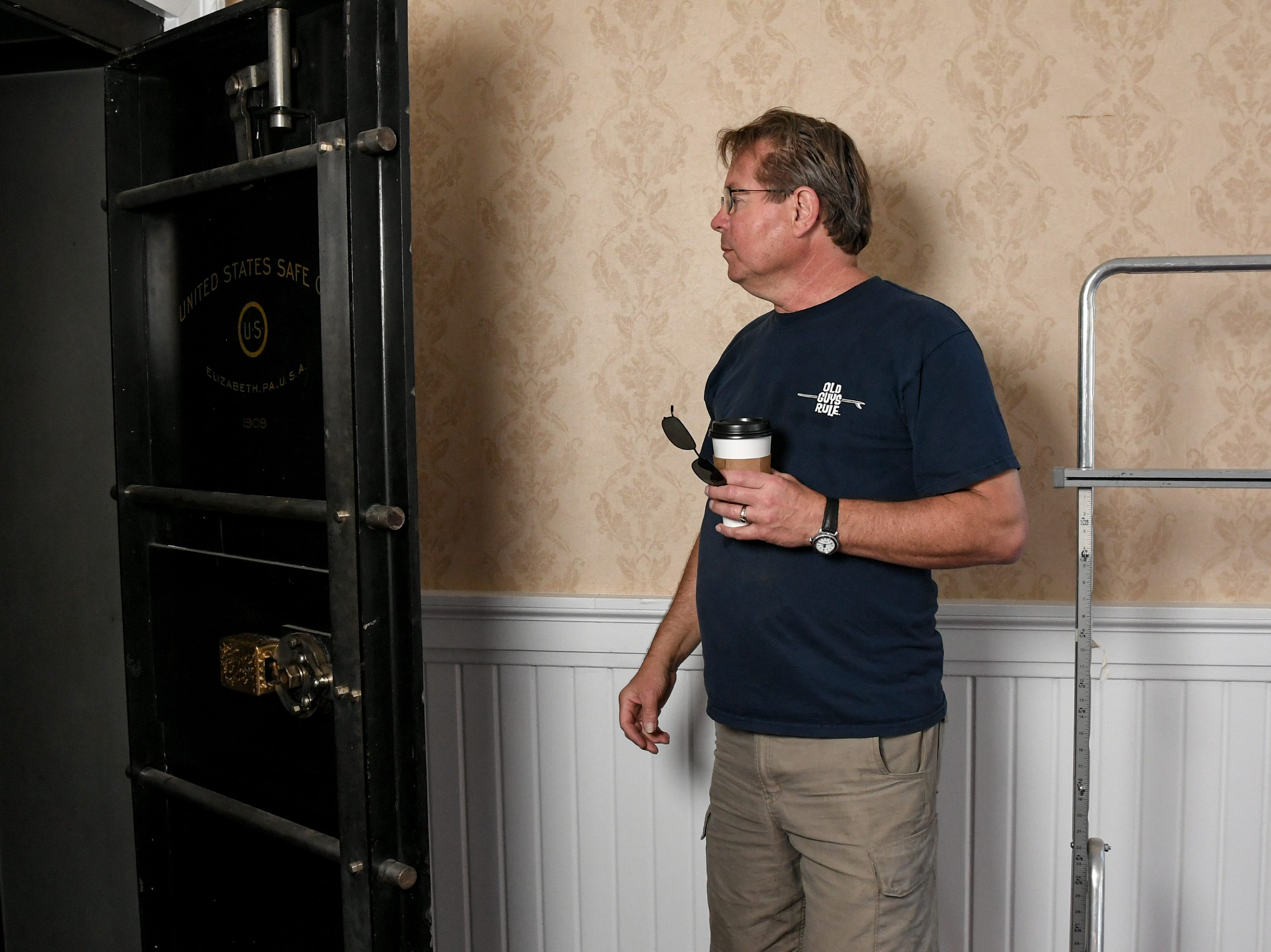 Rick Kummrow looks at an old safe used when a United States Post office was in the building at 401 North Main Street in downtown Anderson. Rick and Ann Kummrow pitched their plan to create The Historic Postmark Anderson, a mix of housing upstairs, retail on the main floor, and possibly a restaurant downstairs. The structure built in 1909 was previously a funeral home, and before that a United States Post Office.
