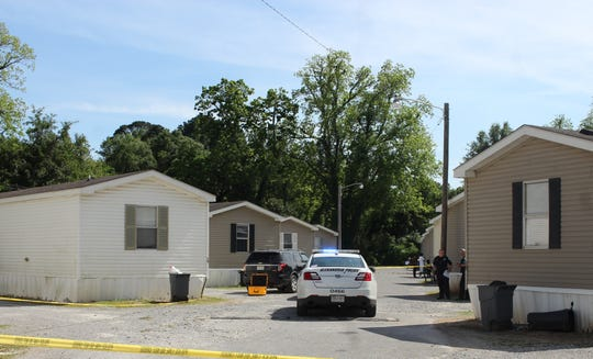 A woman shot a man Monday afternoon in a trailer (second from left) in Alexandria, then apparently shot and killed herself, say police.