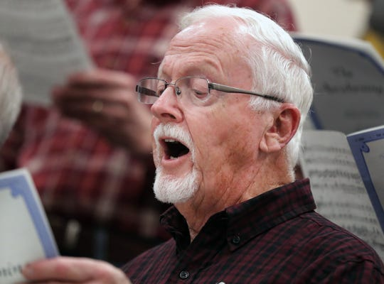 Rick Stark rehearses with the MacDowell Male Chorus, a local arts group celebrating 85 years, at Xavier High  School earlier this month in Appleton.