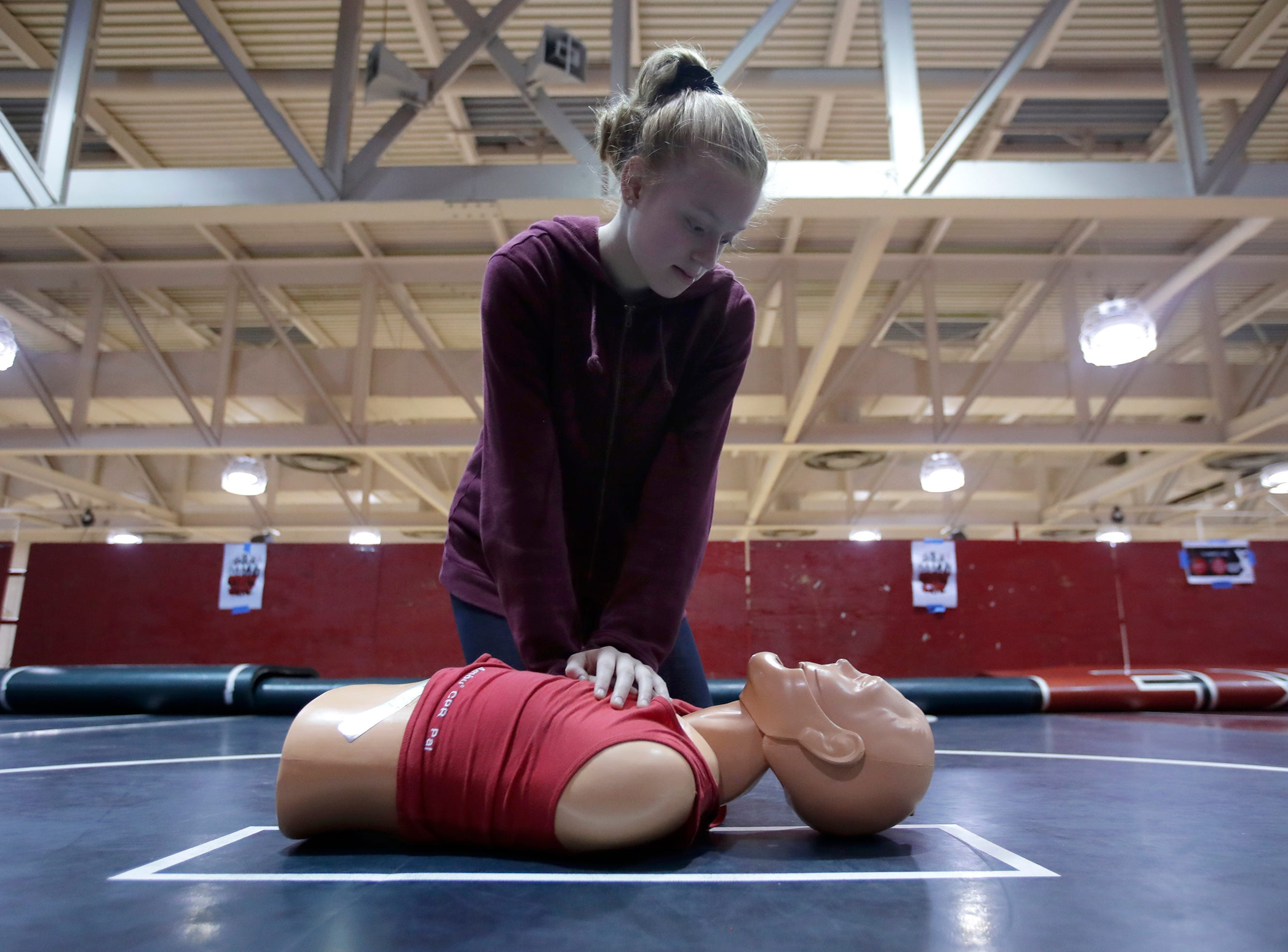 Mary Janssen, in 7th grade at Shattuck Middle School, performs chest compressions on a dummy Thursday, April 18, 2019, in Neenah, Wis. Neenah-Menasha Fire Rescue ran fitness activities to show students some of the physical demands of firefighting. Danny Damiani/USA TODAY NETWORK-Wisconsin