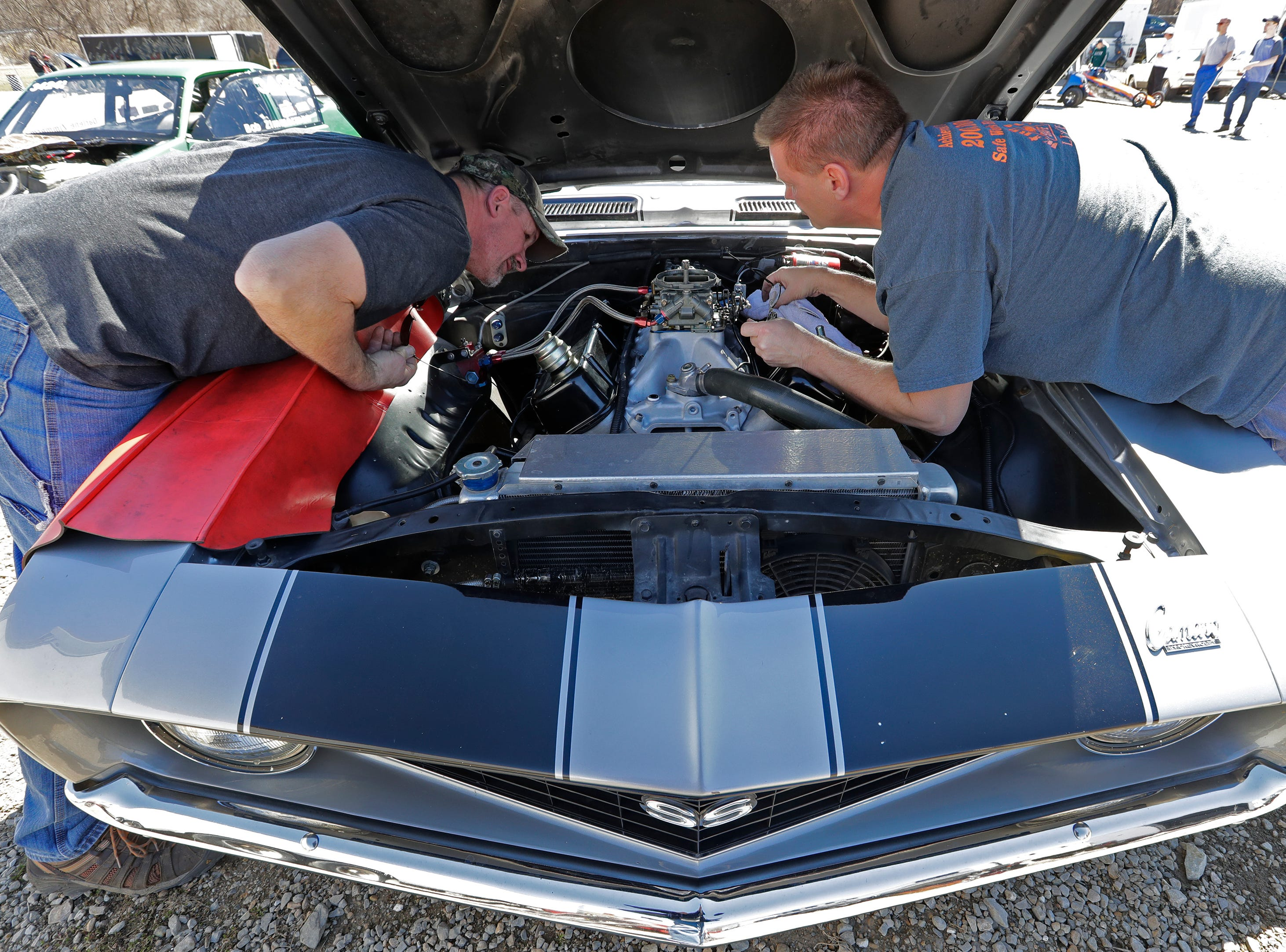 Brothers Tom Schulz, left, of Oshkosh and his brother John Schulz replace a carburetor on Tom's 1969 Camaro during the Wisconsin International Raceway Strip Test & Tune event Saturday, April 19, 2019, in Kaukauna, Wis. Dan Powers/USA TODAY NETWORK-Wisconsin