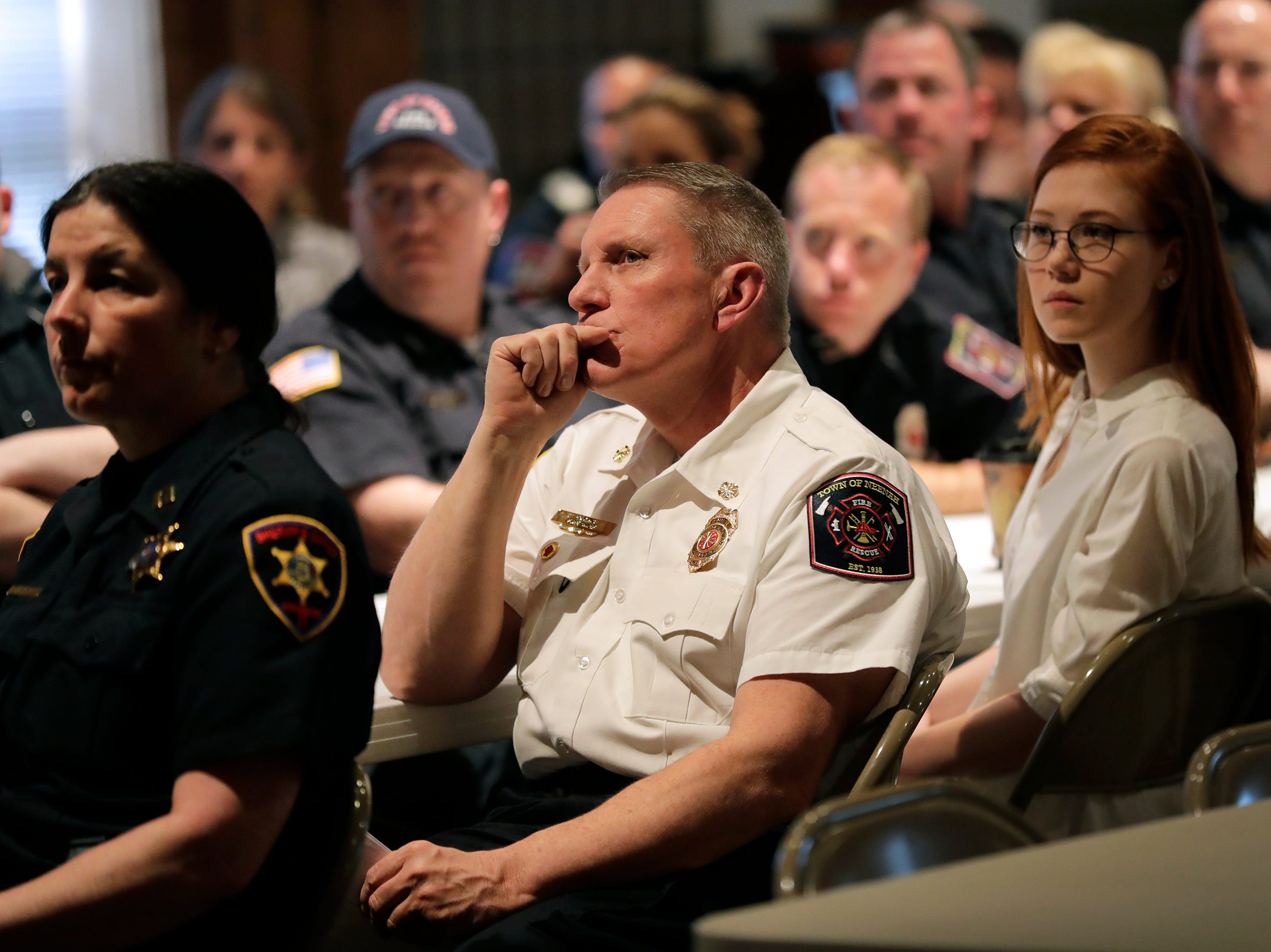 Town of Neenah Fire Department Fire Chief Ed King, center, and other responders watch a video of footage during the I-41 Mass Casualty Incident of Feb. 24, 2019 Recognition Event Tuesday, April 16, 2019, at Gloria Dei Lutheran Church in Neenah, Wis. Dan Powers/USA TODAY NETWORK-Wisconsin